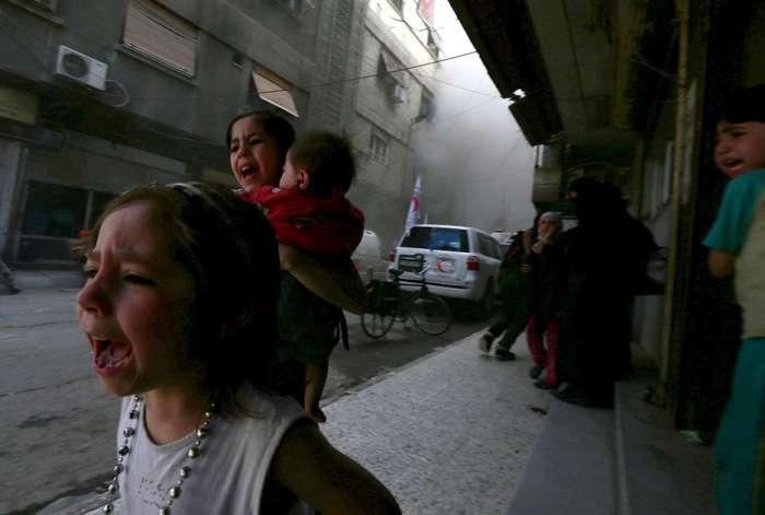 Історії появи найдраматичніших знімків фотокореспондентів Reuters за 2015 рік (14 фото)